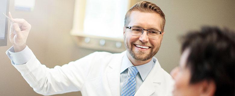 Dentist Providing Patient Education Smiling Aspen Dental